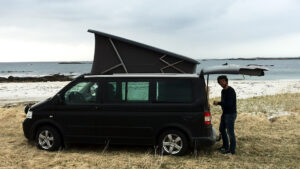 Lofoten VW Camper  Californian camper van with the pop up roof open on a beach