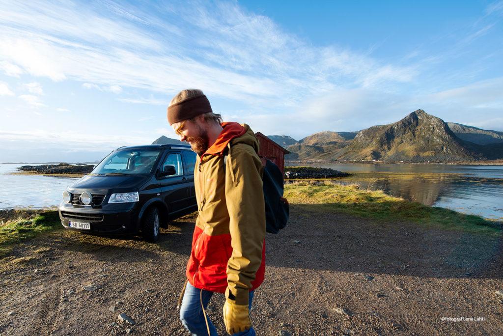 Hiker and a VW T5 California i Lofoten Islands